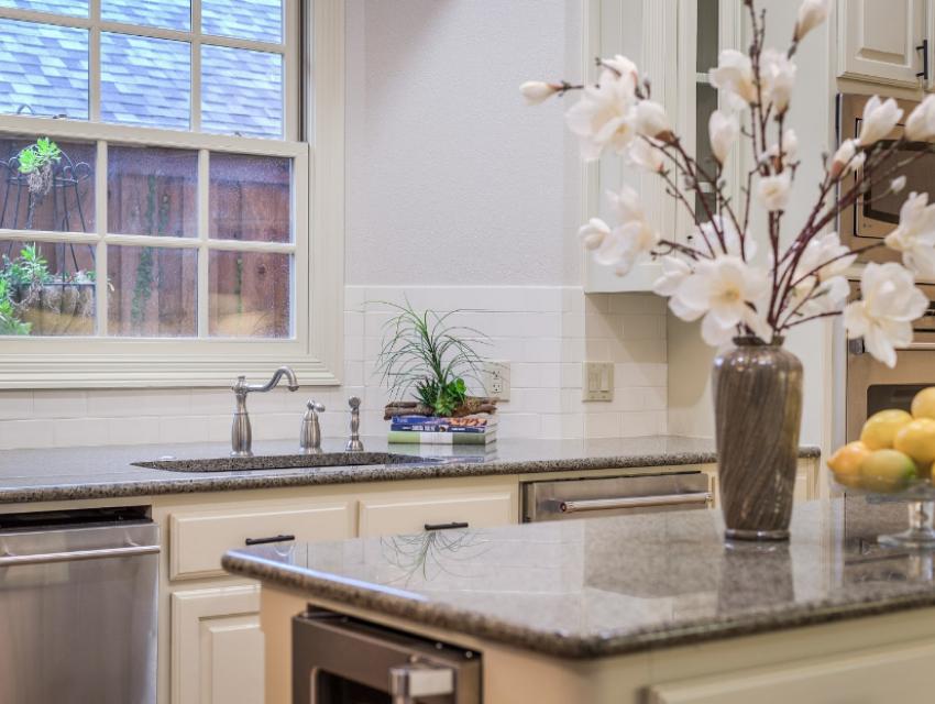 Modern white backsplash updated home renovated to sell design by keti