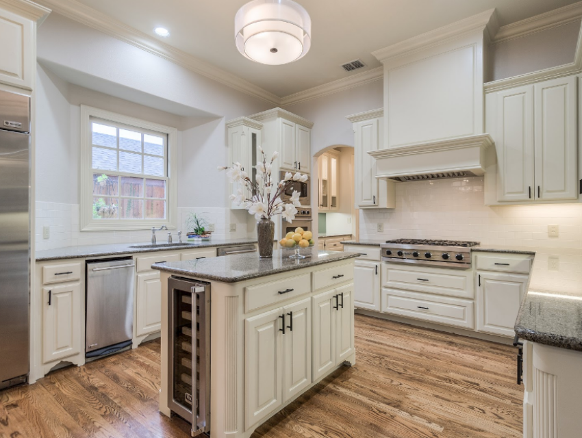 Renovated Dallas home kicthen white cabinets wine fridge updated traditional sophisticated